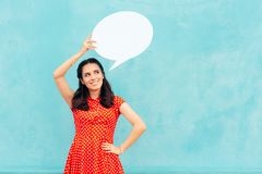 Retro Girl with Speech Bubble Making an Announcement Royalty Free Stock Photography