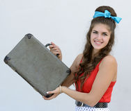Retro girl with suitcase Stock Images