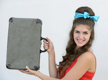 Retro girl with suitcase Royalty Free Stock Photos