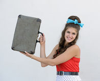 Retro girl with suitcase Stock Photography