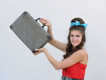 Retro girl with suitcase Royalty Free Stock Images