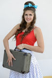 Retro girl with suitcase Royalty Free Stock Photography