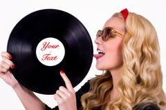 Retro girl touching vinyl LP Stock Image