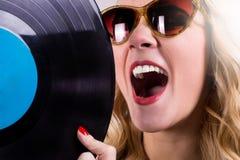 Retro girl touching vinyl LP Royalty Free Stock Photography