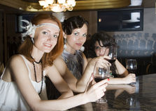 Retro girlfriends at bar Stock Photography