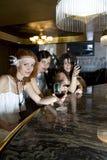 Retro girlfriends at bar Stock Images