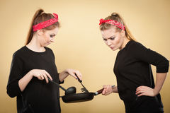 Retro girls cooking and frying on pan. Royalty Free Stock Images