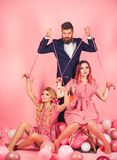 Retro girls and master in party balloons. holidays and dolls. dominance and dependence. Creative idea. Love triangle royalty free stock images