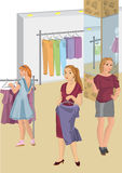 Retro girls in the store picking clothes Stock Images