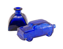 Retro glass blue car small alcohol bottle isolated Royalty Free Stock Photography