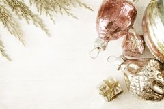 Retro glass christmas toys on wooden panel Stock Photography