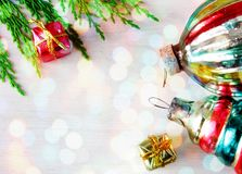 Retro glass christmas toys on wooden panel in xmas lights Stock Photo