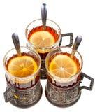Retro glasses with black tea and lemon Stock Photos