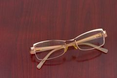 Retro glasses on wooden table Royalty Free Stock Photography
