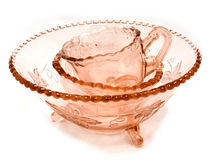 Retro glassware. Stacked vintage old pink glassware, bowls and a cup Royalty Free Stock Images