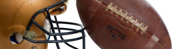 A retro gold football helmet and football on a white background Stock Photography