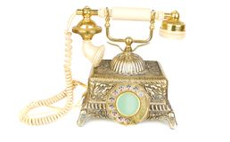 Retro gold phone. Royalty Free Stock Image
