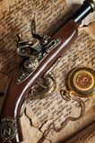 Retro gold pocket watch and antique pistol Stock Images