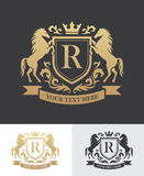 Retro golden crest with shield and two horses. Can be used as logo, emblem or banner for luxury, royal or vintage design concept Stock Images