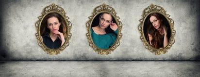 Retro golden frames with portraits Stock Photo