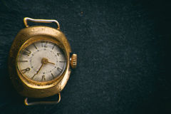 Retro golden watch. On black background Royalty Free Stock Photos