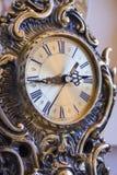 Retro goldish clock. Royalty Free Stock Photography