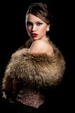 Retro. Gorgeous girl with fur Stock Images
