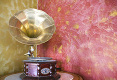 Retro gramophone. Old, restored gramophone on a round table Stock Images