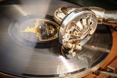 Retro gramophone head. Elder retro gramophone head with needle on scratched disc Stock Image
