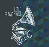 Retro gramophone performed in vintage style. Royalty Free Stock Image