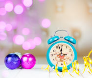 Retro green alarm clock with five minutes to midnight. Royalty Free Stock Photos