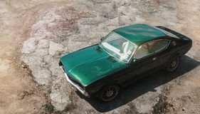 Retro green car. Retro green muscle car on dry land background Stock Photography