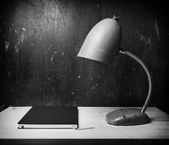 Retro green desk lamp on wooden table Royalty Free Stock Images