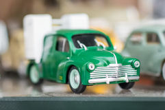 Retro green sport toy car. Green retro sport toy car on a glass stand royalty free stock photos