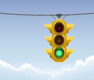 Retro green traffic light. Illustration of a retro green traffic light with clouds in the background Stock Images