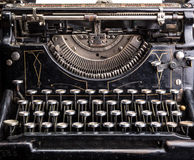 Retro grunge black typewriter closeup Royalty Free Stock Images
