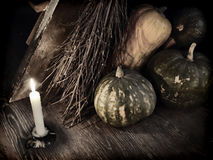 Retro grunge still life with with broom stick, candle and pumpkins_1. Dark mystic ritual with broom stick, candle and pumpkins by staircase.  Occult or esoteric Stock Images