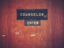 Retro Counselor Office Door. Retro Grungy Counselor`s Office Door At A Public School Or University royalty free stock images