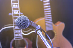 Retro guitar and microphone. Stock Images