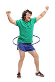 Retro guy exercising with a hula hoop Royalty Free Stock Image