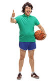 Retro guy holding a basketball Royalty Free Stock Images