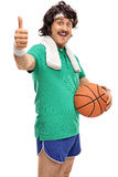 Retro guy holding a basketball and thumb up Stock Photography