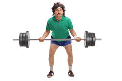 Retro guy lifting a heavy barbell Stock Photography