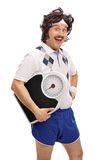 Retro guy posing with a weight scale Stock Photo