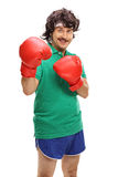 Retro guy with red boxing gloves Royalty Free Stock Image
