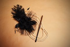 Retro hair ornament. From feathers necklace and a tube for cigarettes Stock Photo