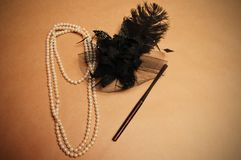 Retro hair ornament. From feathers necklace and a tube for cigarettes Stock Photos