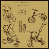 Retro hand drawn baby set for 1-2 years old. Vector illustration of retro hand drawn baby set for 1-2 years old. Includes pram, auto seat, balance bike, tricycle Stock Photo