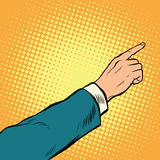 Retro hand pointing to the right up. Pop art vector illustration Stock Photography
