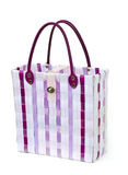 Retro handbag made of woven plastic. Royalty Free Stock Photography